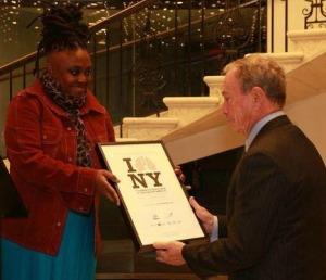 Kimberly Knox gives Mayor Bloomberg the memento