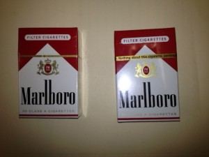 An actual pack next to counterfeit cigarettes.