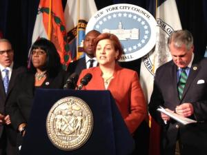 Speaker Christine C. Quinn announces that the NYC Council votes to make NYC the first major city in the nation with a 21 age tobacco sales law