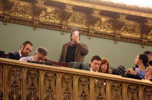 In New York City Council chambers, a e-smoker waits to hear if legislation will pass that will prohibit smoking e-cigarettes at workplaces and indoor public places, such as City Hall.