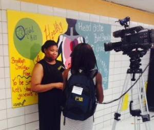Jadaida Glover talking with news reporter.